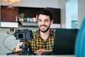 Young Man Doing Web Meeting Using Mirrorless Camera - PhotoDune Item for Sale