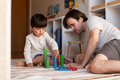 kid and his father playing at home with wood building blocks. Homeschooling. Stay at home. - PhotoDune Item for Sale