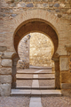 Arabic style arch and door in Spain. Toledo medieval street - PhotoDune Item for Sale