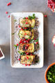 Baked Eggplant Plate Dressed with pomegranate seeds and herbs, flat lay - PhotoDune Item for Sale