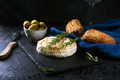 Camembert cheese with rosemary, olives and rustic bread on a dark background - PhotoDune Item for Sale