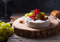 Camembert cheese with fruits and berries on a dark background - PhotoDune Item for Sale