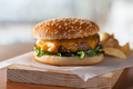 Freshly prepared burger on wooden board with copy space - PhotoDune Item for Sale