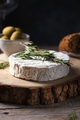 Camembert cheese with rosemary, olives and rustic bread on a wooden background - PhotoDune Item for Sale