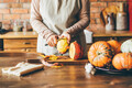 Female hands with knife chopping pumpkin on cutting board. - PhotoDune Item for Sale