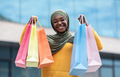 Happy black muslim woman with lots of shopping bags posing outdoors - PhotoDune Item for Sale
