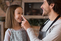 Cheerful Little Girl And Her Young Dad Having Fun In Kitchen Together - PhotoDune Item for Sale