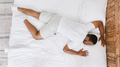 African Man Sleeping Lying On Stomach In Bed At Home - PhotoDune Item for Sale