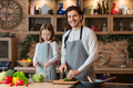 Happy father and daughter cooking breakfast together in kitchen, enjoying organic food - PhotoDune Item for Sale