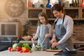Little girl and her dad cooking healthy dinner together at home - PhotoDune Item for Sale