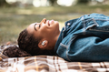 Relaxed African American Girl Listening Music Lying On Plaid Outdoors - PhotoDune Item for Sale
