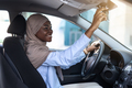 Buying New Car. Muslim African Lady In Hijab Adjusting Rear View Mirror - PhotoDune Item for Sale