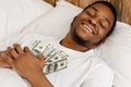 African Man Sleeping Holding Money Lying In Bed At Home - PhotoDune Item for Sale
