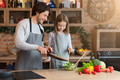 Family Cooking. Cheerful Dad And Little Daughter Preparing Healthy Lunch Together - PhotoDune Item for Sale