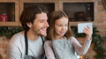 Adorable Little Girl Taking Selfie On Smartphone With Her Dad In Kitchen - PhotoDune Item for Sale
