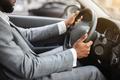 Closeup of black man in suit driving car - PhotoDune Item for Sale