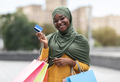 Black Musim Woman Posing With Colorful Shopping Bags And Credit Card Outdoors - PhotoDune Item for Sale