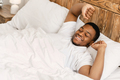 Rested Black Man Waking Up Lying In Bed At Home - PhotoDune Item for Sale