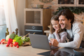 Culinary Blog. Cheerful Young Dad And Little Girl Using Laptop In Kitchen - PhotoDune Item for Sale