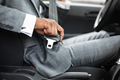 Black man in suit fasten seat belt in his car - PhotoDune Item for Sale