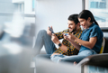 Young Couple Playing Video Game on Phone at Home - PhotoDune Item for Sale