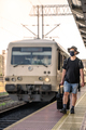 Man with a mask waiting for a train during Covid19 pandemic - PhotoDune Item for Sale
