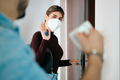 Woman Wearing N95 Mask Before Going Outside - PhotoDune Item for Sale