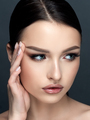 Young beautiful woman touching her face - PhotoDune Item for Sale