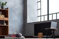 Yoga mat in empty loft room interior with laptop. - PhotoDune Item for Sale