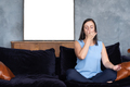 Young caucasian woman working out in living room breathing Pranayama - PhotoDune Item for Sale