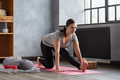 Young woman working out indoors. Girl doing warming up stretching exercise. - PhotoDune Item for Sale