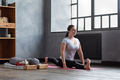 Young woman working outat home doing yoga or pilates exercise - PhotoDune Item for Sale