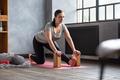 woman doing stretching exercise using props, block, Ardha Hanumanasana - PhotoDune Item for Sale