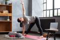 Caucasian woman doing yoga asana at home. - PhotoDune Item for Sale