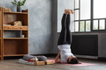 Sporty caucasian woman doing shoulder stand exercise, asana Viparita Karani - PhotoDune Item for Sale