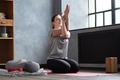 Caucasian woman at room with her crossed arms performing yoga exercise. - PhotoDune Item for Sale
