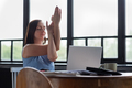 woman with her crossed arms doing yoga exercise resting during working day. - PhotoDune Item for Sale