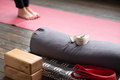 Caucasian females legs on yoga mat with yoga props - PhotoDune Item for Sale