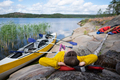 Young caucasian woman resting on riverside after kayaking. - PhotoDune Item for Sale