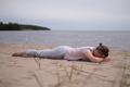 Sporty woman relaxing in yoga asana Makarasana or crocodile pose - PhotoDune Item for Sale