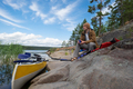 Man sitting on the riverside resting after active paddling - PhotoDune Item for Sale