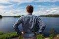 Rear view of man looking lake resting during trekking. - PhotoDune Item for Sale
