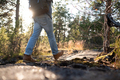Man walking on a path through the forest - PhotoDune Item for Sale