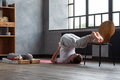 halasana plough pose by caucasian man working out at home. - PhotoDune Item for Sale