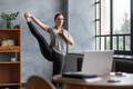 Flexible woman balancing doing asana Standing Hand to Toe at home. - PhotoDune Item for Sale