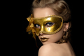 Young beautiful woman wearing golden party mask - PhotoDune Item for Sale