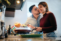 Young Couple Cooking Together And Kissing - PhotoDune Item for Sale
