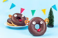 Christmas menu for kids with reindeers made from chocolate doughnut, pretzel cookie, marshmallow - PhotoDune Item for Sale