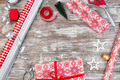 Preparing for Christmas, gift box, different wrapping paper, ribbons and toys on table - PhotoDune Item for Sale