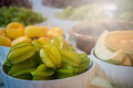 Closeup shot of a bowl of fresh carambola fruits on the table - PhotoDune Item for Sale